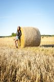 Brunette girl portrait and straw bale Stock Photography