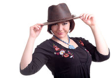 Brunette girl poses in black dress and hat Royalty Free Stock Image