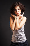 Brunette girl posing on dark background Royalty Free Stock Photo