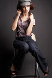Brunette girl posing on dark background Stock Photos