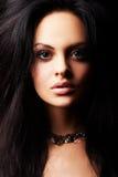 Brunette girl posing on dark background Stock Photo