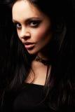 Brunette girl posing on dark background Royalty Free Stock Image
