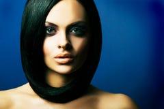 Brunette girl posing on dark background Royalty Free Stock Photo