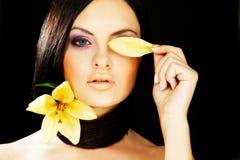 Brunette girl posing on dark background Stock Images