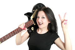 Brunette girl posing with a guitar isolated Royalty Free Stock Image