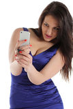 Brunette Girl posing for a photograph taken from his cell phone Royalty Free Stock Photo