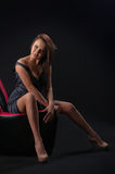 Brunette girl posing in studio on dark background Stock Photo