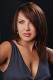 Brunette girl posing in studio on dark background Royalty Free Stock Photo