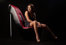 Brunette girl posing in studio on dark background Royalty Free Stock Photos