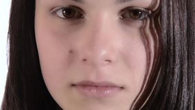 Brunette girl pouting. Studio portrait of a young woman pouting stock footage