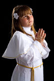 Brunette girl praying for first communion Stock Image