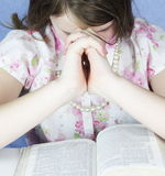 Brunette Girl Prays With Bible Stock Image