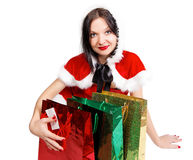 Brunette girl with presents for Christmas Royalty Free Stock Photos