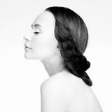 Brunette girl in profile. Portrait of a young woman in profile Stock Images
