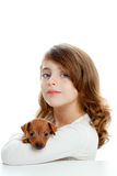 Brunette girl with puppy dog mini pinscher Royalty Free Stock Images