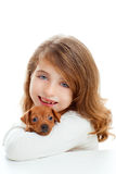 Brunette girl with puppy dog mini pinscher Stock Photo