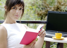 Brunette girl reading a book Stock Photography