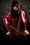 Brunette girl in red with cello Stock Photos