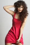 Brunette girl in red dress royalty free stock photography