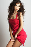 Brunette girl in red dress stock photography