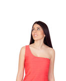 Brunette girl with a red dress looking up Royalty Free Stock Image