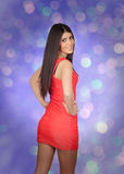 Brunette girl with a red dress on the night Stock Photo