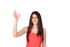 Brunette girl with a red dress saying Ok Stock Image