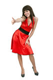 Brunette girl in red dress shows OK Stock Photo