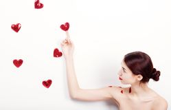 Brunette girl with red hearts Stock Images