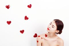 Brunette girl with red hearts Stock Image