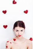 Brunette girl with red hearts Royalty Free Stock Photo