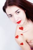Brunette girl with red hearts Royalty Free Stock Image