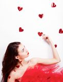 Brunette girl with red hearts Royalty Free Stock Photos