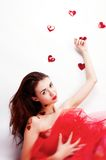 Brunette girl with red hearts Stock Photography