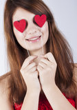 Brunette girl with red hearts. Isolated on white royalty free stock photos