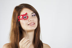 Brunette girl with red hearts. On white royalty free stock photography