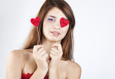 Brunette girl with red hearts. On white stock photo