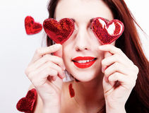 Brunette girl with red hearts Royalty Free Stock Photography