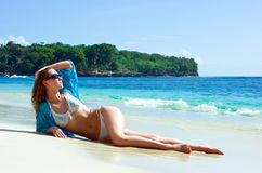 Brunette girl relaxing on the beach Stock Image