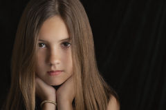 Brunette Girl Resting Chin On Hands Royalty Free Stock Photos
