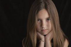 Brunette Girl Resting Chin On Hands Royalty Free Stock Images