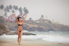 Brunette girl run on the beach Stock Image