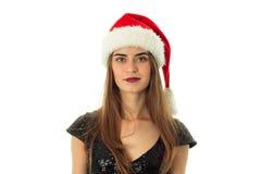 Brunette girl in santa hat Stock Image