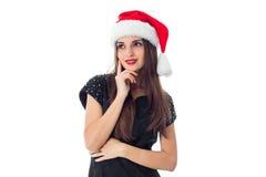 Brunette girl in santa hat Royalty Free Stock Photography