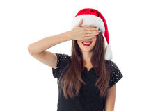 Brunette girl in santa hat Royalty Free Stock Image