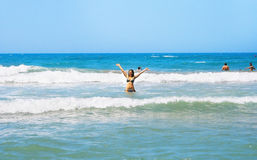 Brunette girl in the sea Royalty Free Stock Image