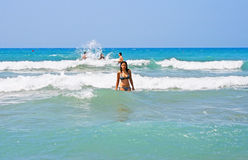 Brunette girl in the sea Stock Images