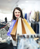 Brunette girl with shopping bags Royalty Free Stock Image