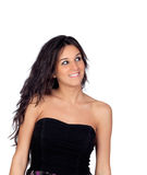 Brunette girl showing her shoulders with a black dress Royalty Free Stock Photography