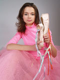 Brunette girl  shows footwear po Royalty Free Stock Image